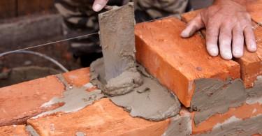 Mason building brick wall
