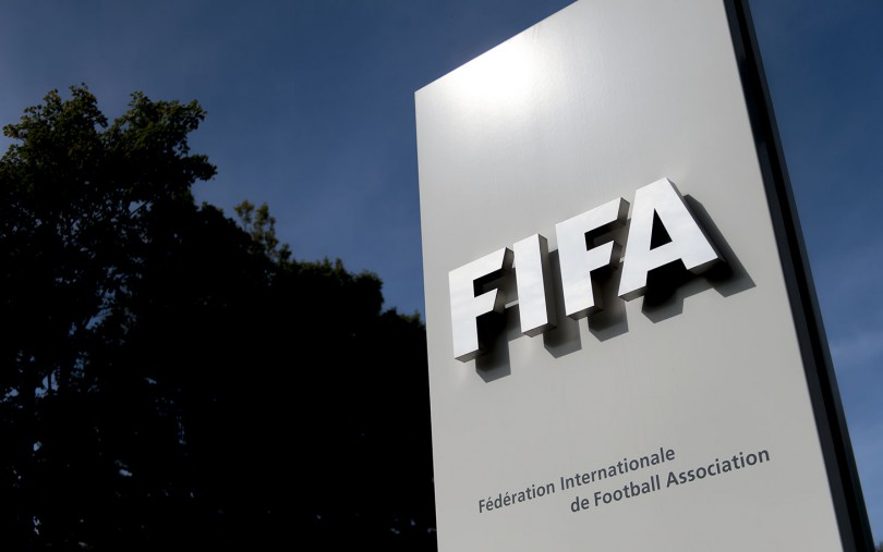 The logo of the global football's governing body FIFA is seen on October 3, 2013 at its headquarters in Zurich. FIFA kicked off a crunch meeting behind closed doors, amid claims of rights abuses by 2022 World Cup Qatar and wrangling over plans to hold the tournament in the winter.  AFP PHOTO / FABRICE COFFRINI        (Photo credit should read FABRICE COFFRINI/AFP/Getty Images)
