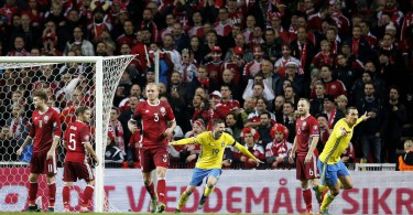 Sweden's Zlatan Ibrahimovic, right, celebrates scoring during the Euro 2016 qualifier play-off second leg soccer match against Denmark at Parken Stadium in Copenhagen, Denmark, Tuesday Nov. 17, 2015. (Gregers Tycho/Polfoto via AP) DENMARK OUT