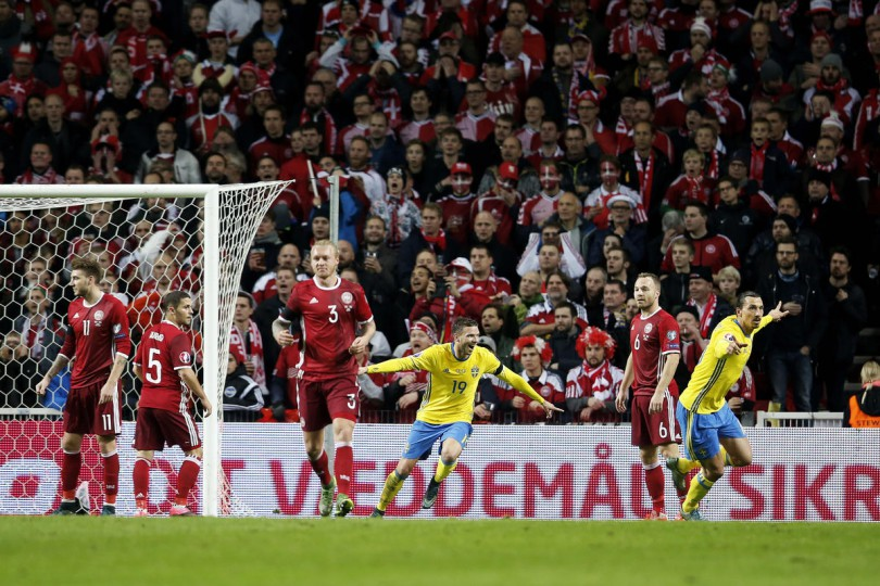 Sweden's Zlatan Ibrahimovic, right, celebrates scoring during the Euro 2016 qualifier play-off second leg soccer match against Denmark at Parken Stadium in Copenhagen, Denmark, Tuesday Nov. 17, 2015. (Gregers Tycho/Polfoto via AP) DENMARK OUT