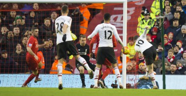 Manchester United's Wayne Rooney, right, scores during the English Premier League soccer match between Liverpool and Manchester United at Anfield Stadium, Liverpool, England, Sunday, Jan. 17, 2016. (AP Photo/Jon Super)