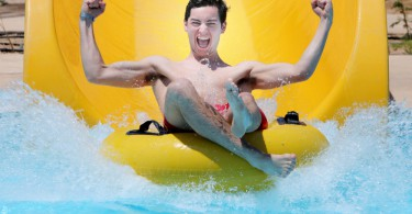 Seb Smith who has landed the world's most fun job - as a WATER SLIDE tester.  See SWNS story SWSLIDE.  A lucky university student has landed the world's most fun job - as a WATER SLIDE tester.  Delighted Seb Smith, 22, beat off competition from 2,000 applicants to fill the GBP20,000-a-year role with holiday company First Choice.  Seb will now spend the summer travelling to exotic locations across the globe where he'll ride and rate the exhilarating chutes.  The Design Technology student will visit sunny locations such as Majorca, Turkey and Egypt and stay at the firm's 20 Splash World resorts over a six-month period.  Yesterday (Wed), Seb, who is studying at the University of Leeds, described the ultimate summer job as a 'dream come true'.