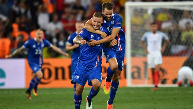 (LtoR) Iceland's defender Ragnar Sigurdsson and Iceland's defender Kari Arnason celebrate their team's win after the Euro 2016 round of 16 football match between England and Iceland at the Allianz Riviera stadium in Nice on June 27, 2016.  .Iceland won the match 1-2. / AFP / BERTRAND LANGLOIS        (Photo credit should read BERTRAND LANGLOIS/AFP/Getty Images)
