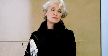 Meryl Streep in The Devil Wears Prada, showing that grey hair never gets old.