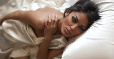 Sexy woman in satin sheets