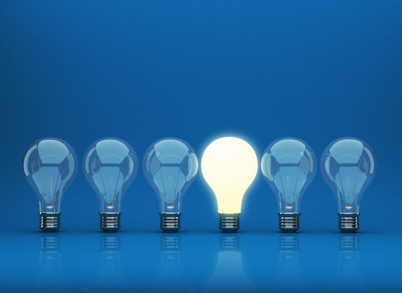 Row of light bulb 3D on blue background. Innovation concept.